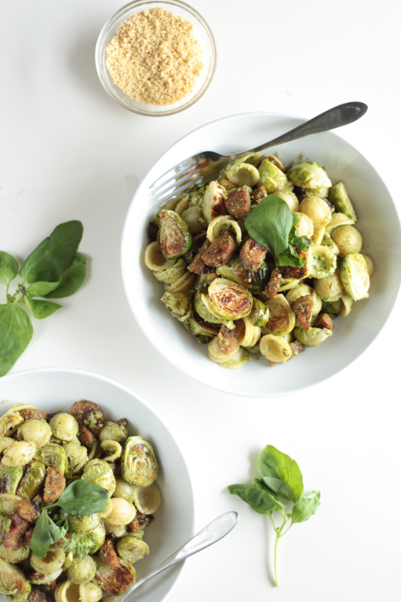 Roasted Brussels Sprouts and Vegan Sausage Tossed in Herby Vegan Pesto