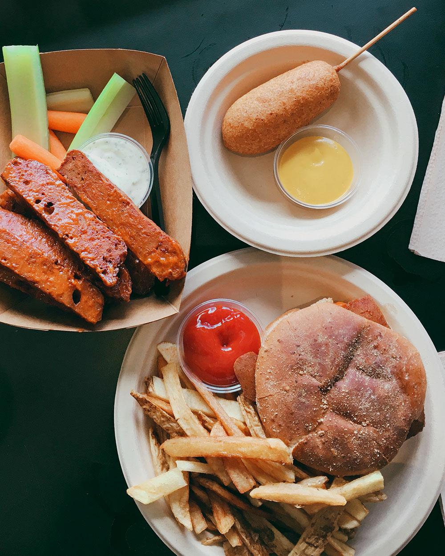 The Ultimate Guide to the BEST Vegan Food in Denver. Seitan wings, corndog, burger and fries from Vegan Van Food Truck.