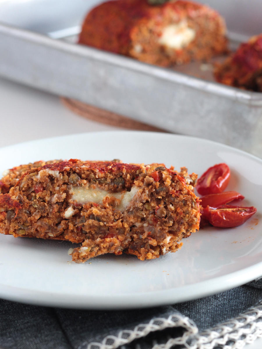 Vegan Italian Meatloaf made with Lentils Mushrooms and stuffed with Vegan Mozzarella