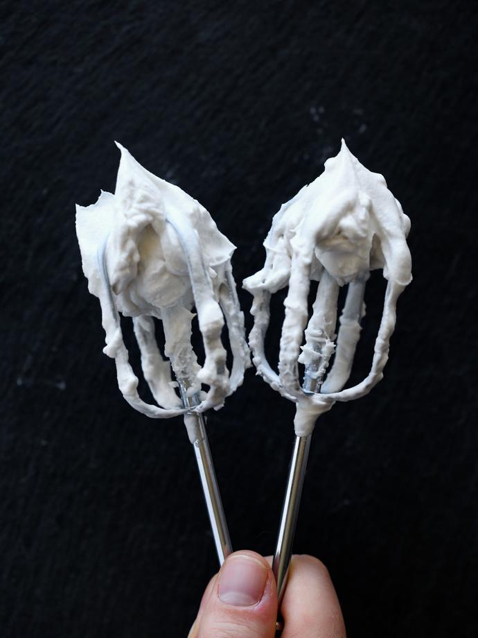 vegan whipped cream on beaters.