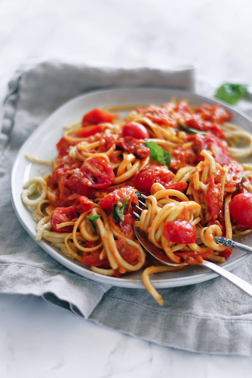 easy, simple, fresh grape tomato sauce by pasta-based. a mix of wheat spaghetti and yellow squash noodles mixed with light, fresh grape tomato sauce.