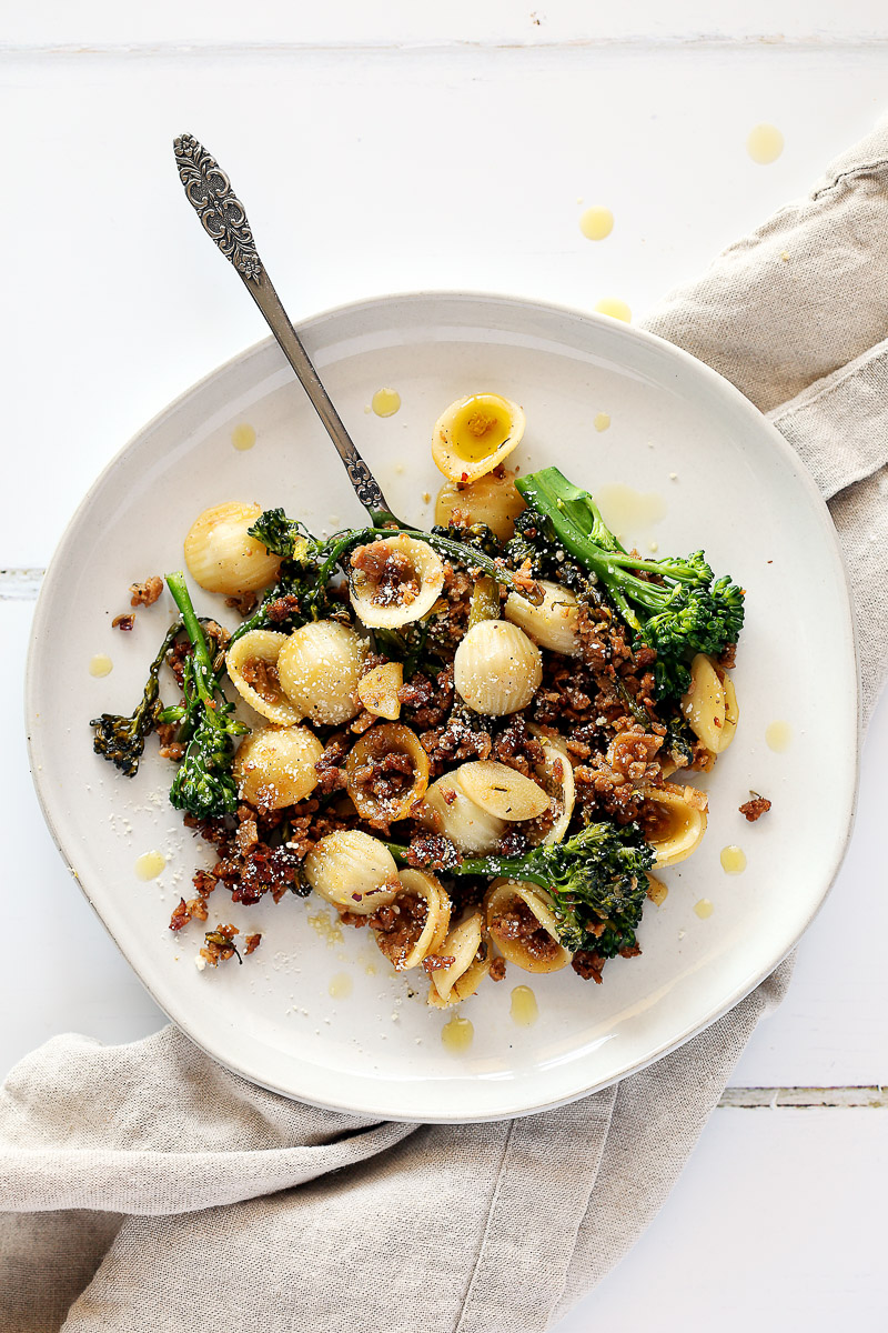Italian Sausage Crumbles by Pasta-based. A plate of orecchiette pasta mixed with broccolini, vegan sausage crumbles, and fresh browned garlic.