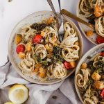 Creamy Fettuccine with Roasted Butternut Squash and Broccolini. Three plates filled with fettuccine pasta, creamy vegan sauce, roasted butternut squash, roasted grape tomatoes, and fresh roasted broccolini.