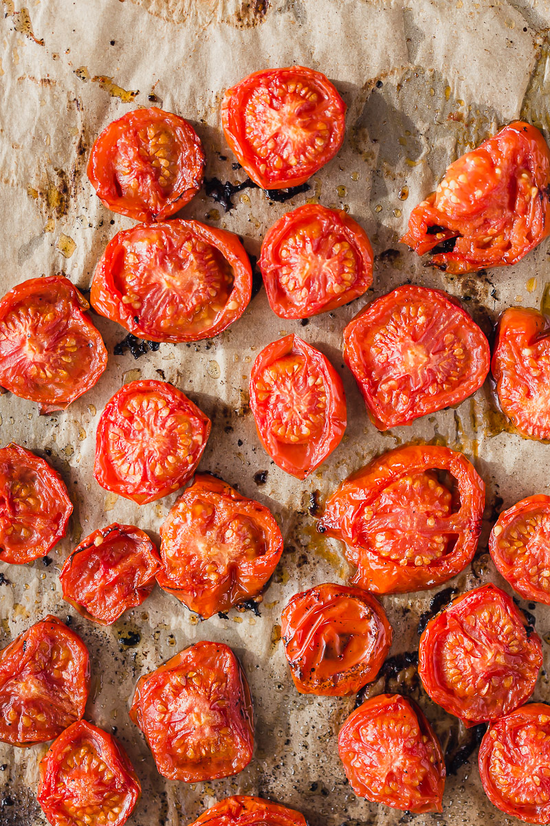 Oven Roasted Campari Tomatoes by Pasta-based. Juicy, bright red, sliced campari tomatoes roasted with a light olive oil drizzle on natural unbleached parchment paper.