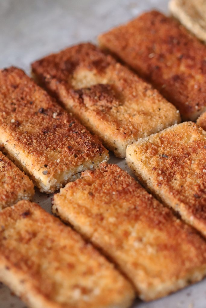 Close up image of browned crispy tofu cutlets.